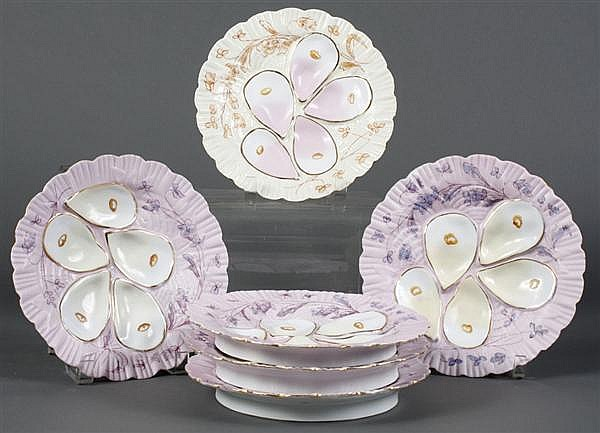 SET OF SIX ANTIQUE GERMAN PORCELAIN OYSTER PLATES - With handpainted flowers. Five have a pink ground, one has an ivory ground. Five...