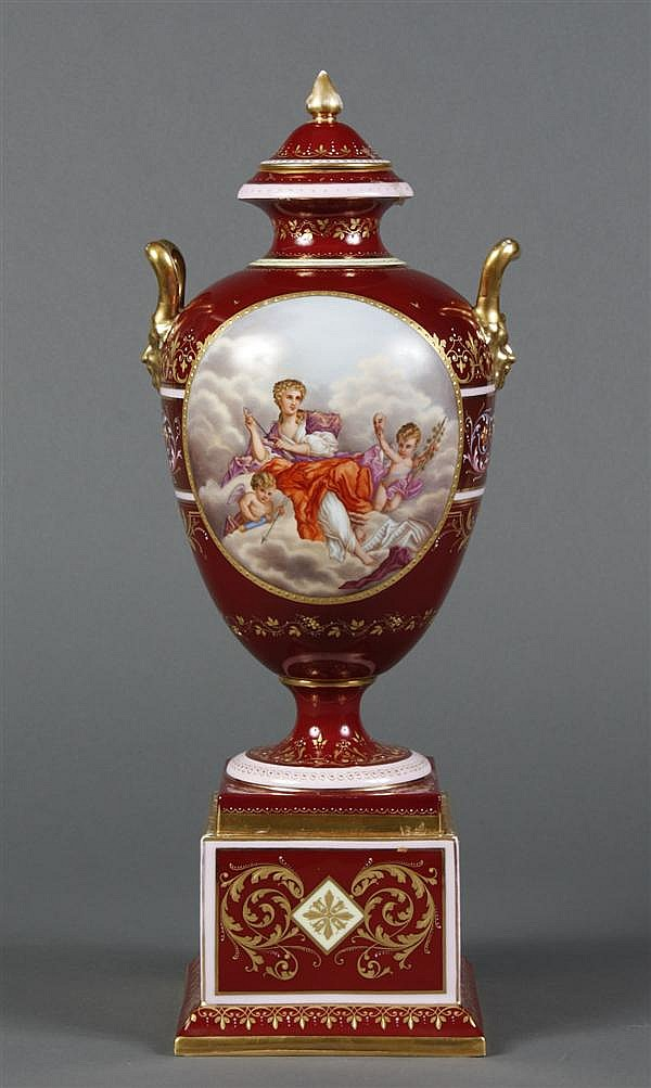 ROYAL VIENNA PORCELAIN URN - With an ovoid cartouche on either side with hand painted scenes of a romantic couple and of Venus, Cupi...