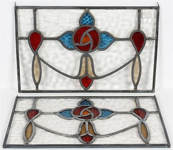 PAIR LEADED AND STAINED GLASS WINDOWS - With red, blue and light yellow stained glass in a flower-like design surrounded by clear gl...