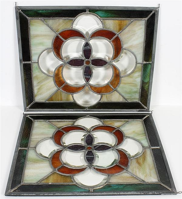 PAIR LEADED AND STAINED GLASS WINDOWS - With gold and green stained glass set in a flower-like design with a small faceted center; a...