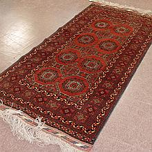 CARPET: HANDWOVEN RUSSIAN TEKKE - All wool with eight octagonal medallions on a red field divided by hexagonal lozenge devices and b...