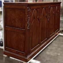 SALON CABINET - Contemporary Gothic style oak with four door configuration, brass hardware and interior shelves. Condition good. Lat...