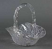 INVERSE CUT GLASS BASKET WITH HANDLE - Clear glass cut on the outside with a pattern of assorted fruit. Apparently unsigned. Overall...
