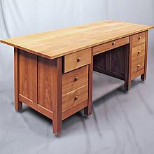 DOUBLE PEDESTAL DESK - Custom cherry wood construction with planked top, turned pulls and square legs. Condition good with some surf...