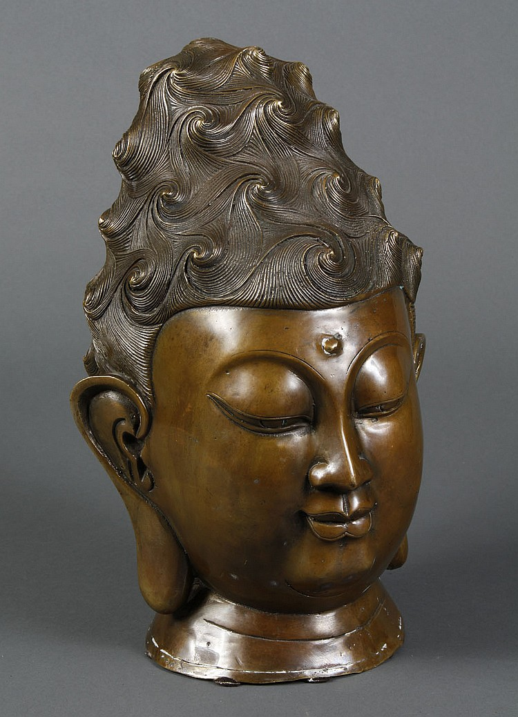 BRONZE BUDDHA HEAD - Cast bronze head of Buddha Shakyamuni with hair styled in waves. Condition good. 14