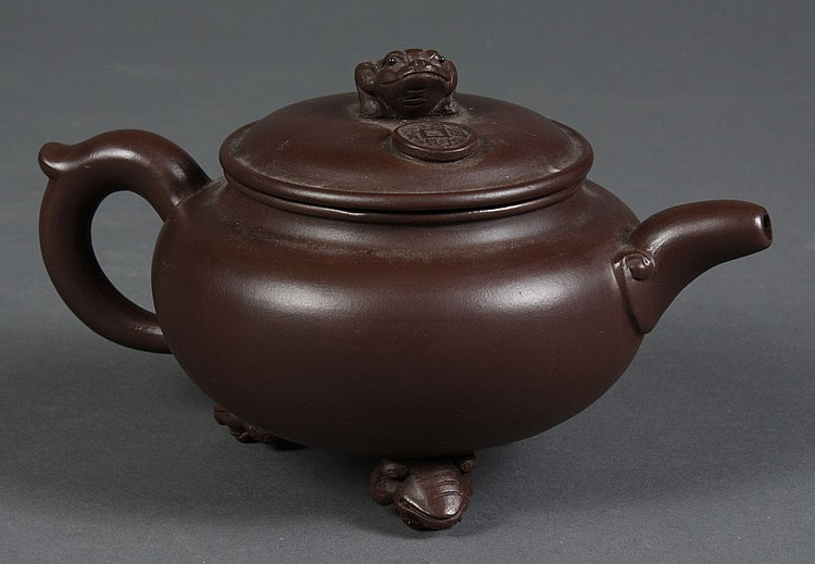 CHINESE YI XING CLAY TEA POT - Dark brown with long tailed frog and a lucky coin on the cover; three long tailed frog feet. Stamp to...