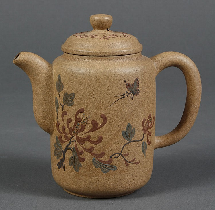 CHINESE YI XING CLAY TEA POT - Beige cylinder shape with painted chrysanthemum and butterfly; calligraphy on the reverse; with cover...