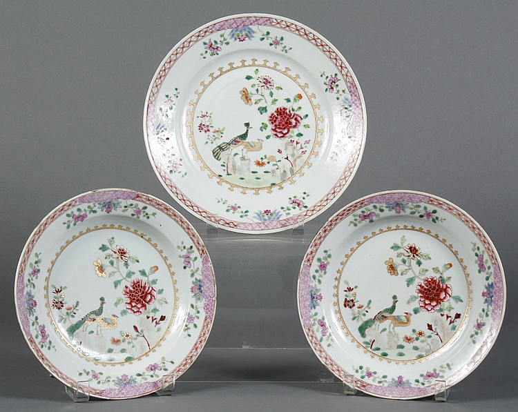 SET OF THREE CHINESE PORCELAIN EXPORT PLATES - With peacocks and chrysanthemum on the plate floor; two plates are the same size, one...