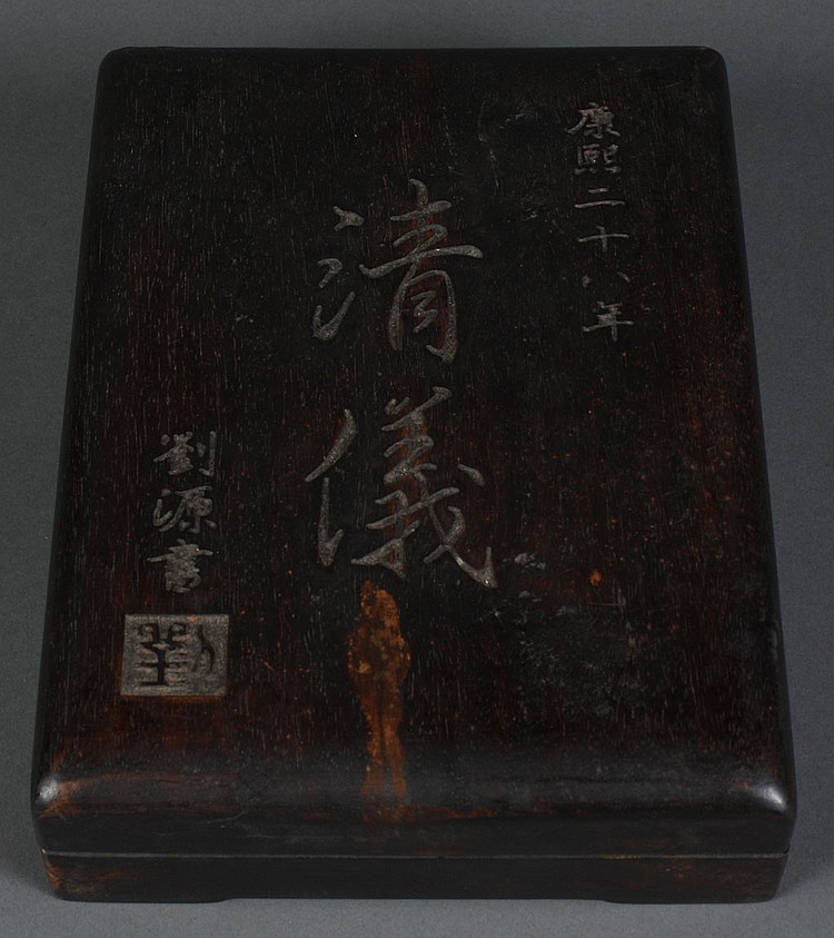 CHINESE INKSTONE IN WOODEN BOX - Inkstone with calligraphy resides in a fitted wooden box. With character seal on cover. Condition g...