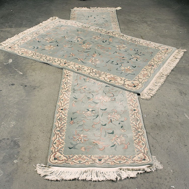 CARPET: HAND-KNOTTED LOT OF TWO CHINESE SCULPTURED - Wool on a cotton warp with celadon field, and stylized floral borders. Lot to i...