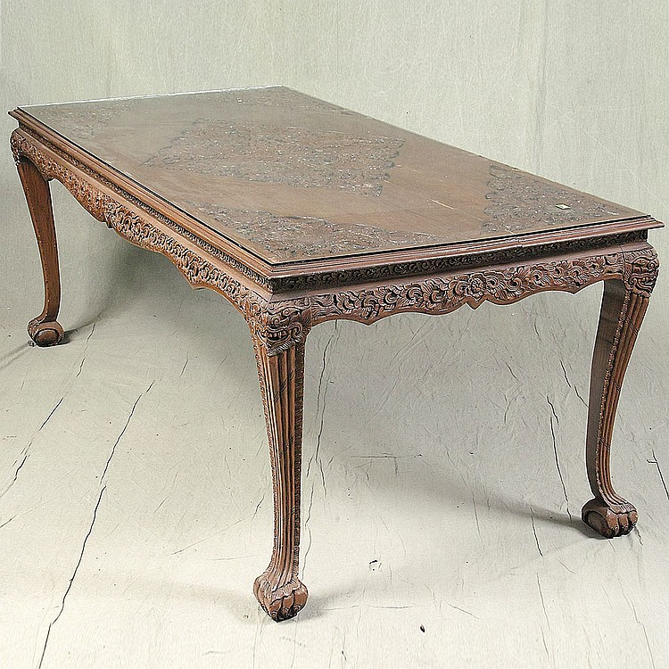 TABLE AND CHAIRS - Indonesian rosewood with highly detailed floral and foliate incised decoration throughout, rectangular table with...