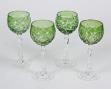 FOUR CUT CRYSTAL HOCK GLASSES - Green cut to clear cup with a clear cut stem and foot. Could be Waterford; Lismore pattern but not m...
