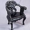 ARMCHAIR - Antique Japanese with high-relief carved back and seat, decorations in the form of dragons among the clouds, and cabriole...