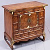 CHEST OF DRAWERS - Korean-style elm with rectangular top, multiple drawers with brass hardware and ox-hoof style feet on skid base....