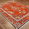 CARPET: HANDWOVEN INDO-PEKING - Wool on a cotton warp with blue and cream floral and foliate designs, brick colored field, Condition...