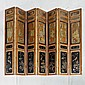 CHINESE FOLDING SCREEN - Vintage seven-panel screen with gilt floral decorations, seven vignettes of domestic life, incised calligra...