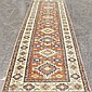 CARPET: HANDWOVEN KAZAK STYLE RUNNER - Wool on a cotton warp with multiple latch-hook star medallions on a variegated red field surr...