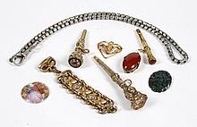 VARIOUS ANTIQUE WATCH FOBS AND CHAIN - Eight loose watch accessory parts: three apparently unmarked gold color metal chatelaine penc...