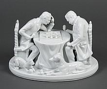 BLANC DE CHINE PORCELAIN FIGURAL GROUP - Portrays two gentlemen pondering their next chess move while a dog and cat play with the sp...