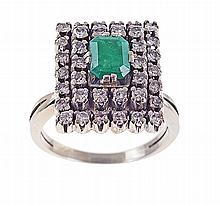 White gold ring set with emerald and 46 brilliant cut diamonds. Hallmarked.