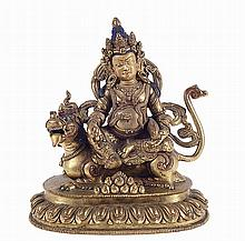 Gilt bronze figure of Buddah with a dragon.