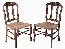 Set of 8 carved wood chairs.