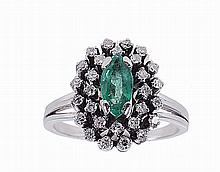 White gold ring with an emerald and 28 diamonds.