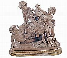 A FRENCH TERRACOTTA GROUP OF PLAYFUL PUTTI WITH A GOAT AFTER CLODION