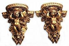 PAIR OF CONTINENTAL GILT WOOD CHERUB WALL SHEVLES