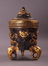 Exquisite antique Chinese Bronze Urn with Elephant head feet and figural demons throughout.  Beautiful detail and in great condition.  Original execution date unknown, remained in a private estate collection since mid 1900's.  (Size: See last photo