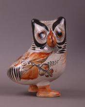Hand painted pottery of an Owl.  (Size: See last photo for measurement.)