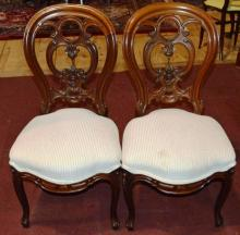 Pair of French carved Walnut Upholstered Balloon-back parlor chairs