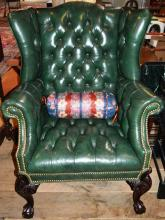 Green leather upholstered Chippendale style wing chair