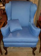 Blue upholstered Queen Anne style wing chair