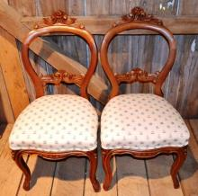 Pair of carved walnut Victorian balloon back upholstered parlor chairs