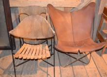 Three modern chairs including large leather and metal frame club chair