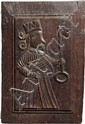 Paire de panneaux de forme ovale en chêne sculpté en bas-relief représentant, sur l'un, un saint barbu céphalophore et, sur l'autre,