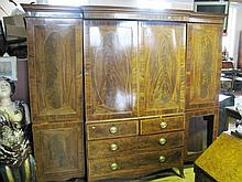 A Nineteenth Century Figured Mahogany Breakfront Wardrobe with crossbanding and stringing and standing on swept bracket feet, 237 x 207 x 63cm