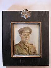 A World War One Portrait Miniature of a young officer, signed Laura Adams