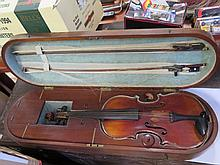A Nineteenth Century Violin in a mahogany and brass fitted case and with six bows