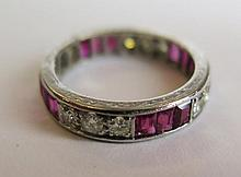 A Ruby and Diamond Eternity Ring, ruby 1.3ct and diamond 1ct