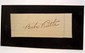 BABE RUTH SIGNATURE ON PIECE OF PAPER MOUNTED TO A BLACK BACKING