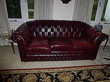Three Seater Burgundy Coloured Leather Lounge