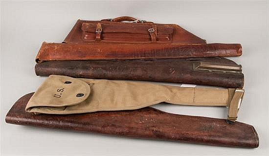 Collection of leather gun cases including 1 shotgun leather case; 2 military carbine leather cases; 1 carbine leather case. All in g...