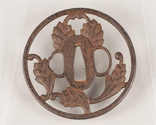 Japanese iron decorative sword Tsuba in the form of a cut-out floral design