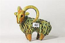 A 1960's STUDIO POTTERY GOAT FIGURINE. Height 14cm.