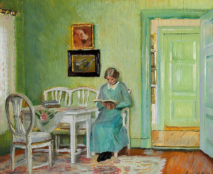 Helga Ancher: Interior from a green sitting-room with a young woman reading.