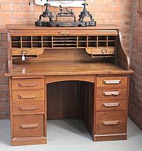 An Oak Rolltop Desk, c 1910, the short rectangular