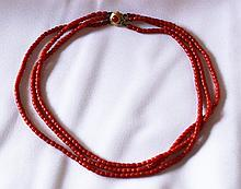 A Late 19th Century Triple Strand Yellow Gold and Coral Necklace , c 1900