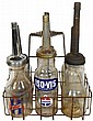 Petroliana, 6 oil bottles in wire carrier,